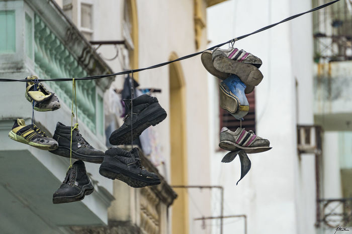 Colonial Cities Popular Neighborhoods Decaying Beauty Focus On Foreground Folklore Full Length Havana Vieja Seletive Focus Shoes Street Photography Streetphotography Travel Destinations