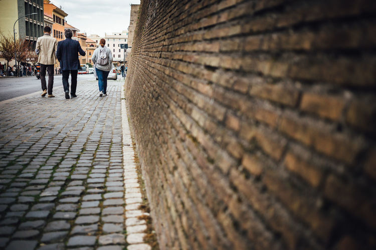 Brick Wall Lines Moving Around Rome Rome VaticanCity Walking Around Architecture Building Exterior Built Structure City Cobblestone Lifestyles Real People Street Streetphotography vanishing point Vatican Museum Walking