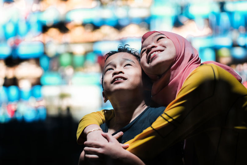 Moments Of Happiness Two People Togetherness Emotion Positive Emotion Happiness Smiling Love Women Bonding Headshot Portrait People Siblings Woman In Hijab Technology