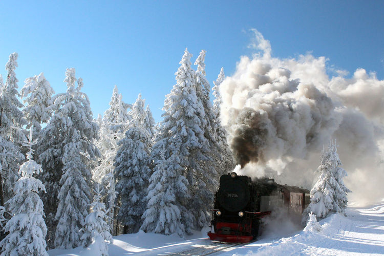 Backlight Black Steam Engine Blue Sky Cold Winter ❄⛄ Environment Environment Pollution Locomotive Mountain Mountains Pollution In My World Snow Steam Steam Locomotive Steam Train Transportation Tree Trees Winter
