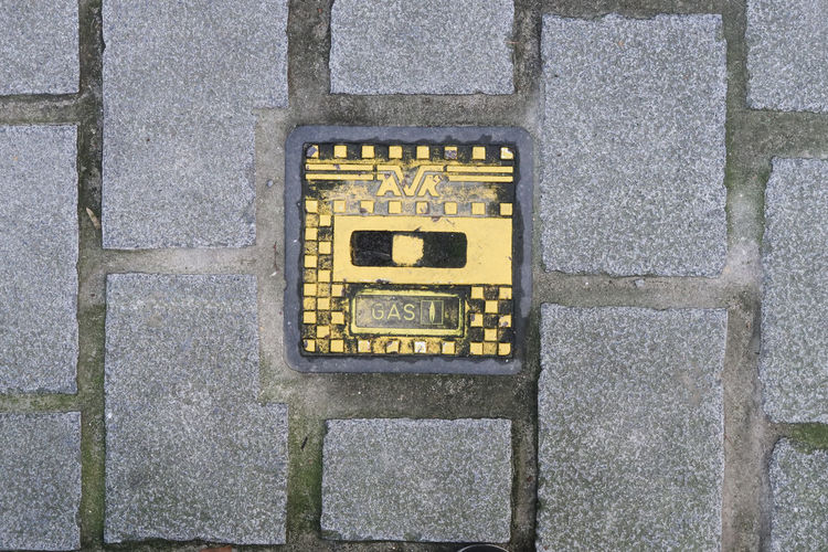 Antwerp, Belgium - December 4, 2018; Iron gas manhole cover of AVR in the pavement of a walking street in Antwerp Manhole Cover Manhole  AVR Pavement Gas Outdoors Backgrounds Sign Walking Street Antwerp Antwerp, Belgium