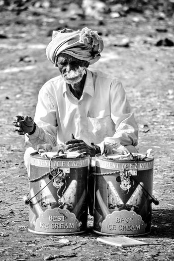 A lonely Indian icecream vendor. People And Places Oldmanportrait Oldman Poser VillagePeople Villagelife Peopleportraits Indiapictures Eyembestshots Canon Eos