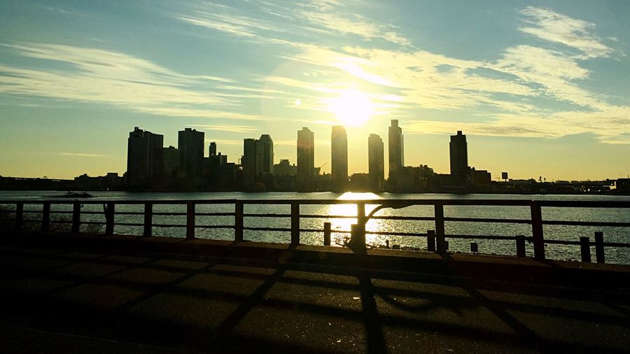 Sunrise over the East River on the freeway in Manhattan, NYC River Sunrise Sky Sunlight Urban Skyline Skyscraper City Cloud - Sky Sun Water Architecture Cityscape Day Outdoors Manhattan FDR Drive East River Exposure