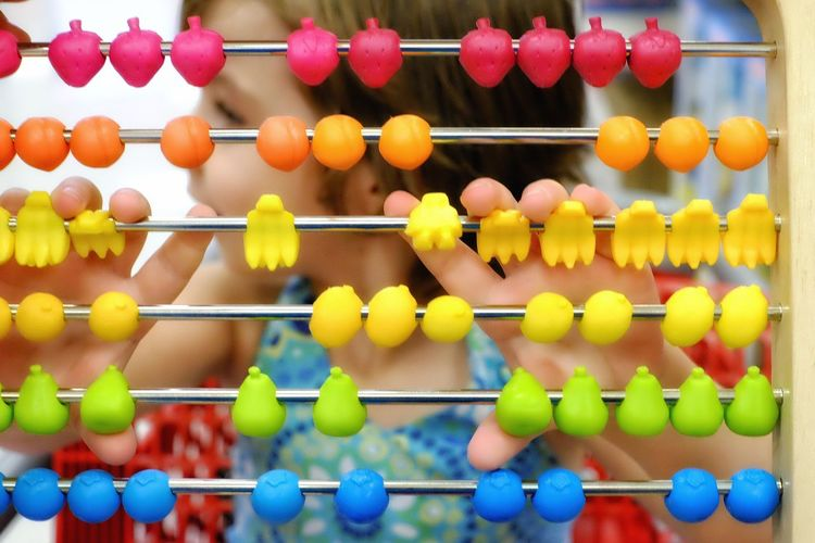 Girl playing with abacus at home