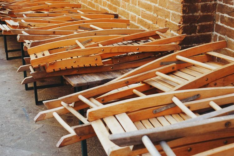 High angle view of folded wooden chairs
