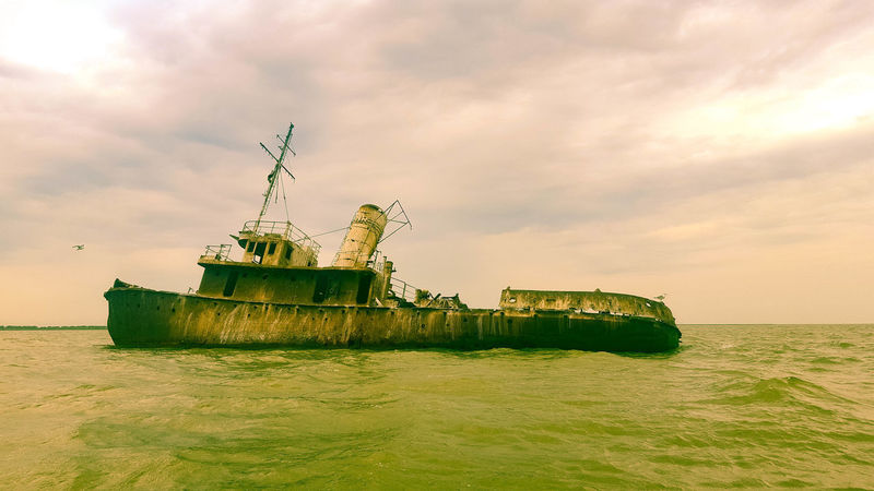 Delta Danube cruise Delta Danube Wreck Abandoned Beauty In Nature Boat Cloud - Sky Damaged Day Horizon Over Water Nature Nautical Vessel No People Outdoors Scenics Sea Sky Sunken Tranquility Transportation Water Waterfront