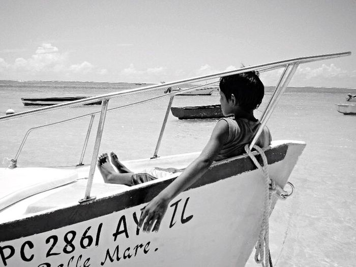 Throwback Throwbackthursday  Mauritius Ilemaurice 🎈👻 Blackandwhite Black And White Black & White Blackandwhite Photography Horizon Over Water Transportation Sea Nautical Vessel Beach Mode Of Transport Day Outdoors Sky Moored Water Real People Sand Men One Person Nature Yacht Boat Deck Sailor