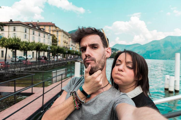 Portrait of couple against lake