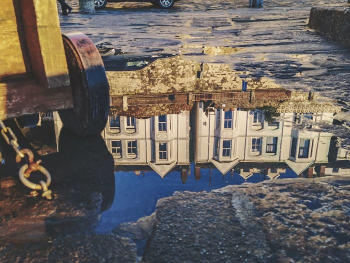 ways of seeing your surroundings. reflections in puddles EyeEmMagazine Eyeemoninstragram Different Different Perspective Personal Perspective Ways Of Seeing Britain Uk Canon And Puddles Reflections In The Water Porthleven Through Puddles Upside Down Streetphotography EyeEm Best Shots Water Puddle Architecture Building Exterior Built Structure Residential Structure Historic Old Town My Best Photo