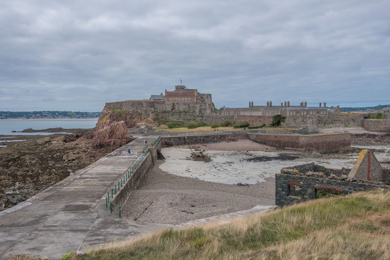 Channel Islands Elizabeth Castle, Jersey Ancient Ancient Civilization Archaeology Architecture Building Exterior Built Structure Cloud - Sky Day Environment Grass History Land Nature No People Old Old Ruin Outdoors Ruined Sky The Past Tourism Travel Travel Destinations Water