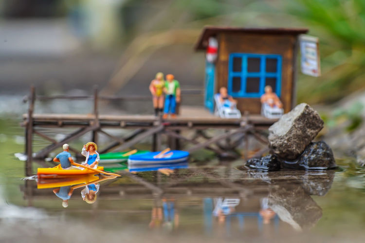 Toys on boat in lake