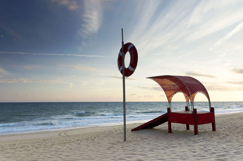 View of calm beach against sky