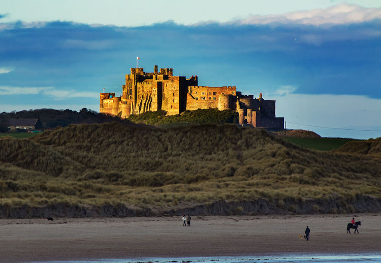 Castle aglow Bamburgh Castle Ancient Ancient Civilization Architecture Banburgh Beach Building Exterior Built Structure Castle Day Dusk Fort Glow History Leisure Activity Mountain Nature Outdoors Real People Sky The Past Tourism Travel Travel Destinations