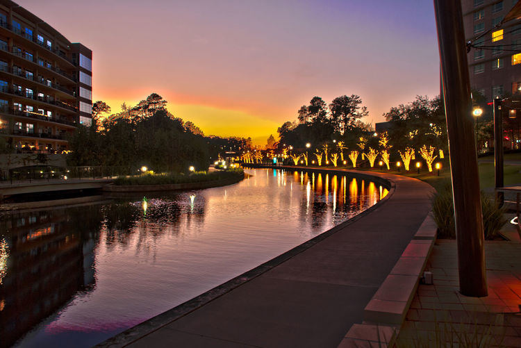 The Waterway Architecture Building Building Exterior Built Structure Canal City City Life Illuminated No People Orange Color Outdoors Reflection Sky Sunset Sunset #sun #clouds #skylovers #sky #nature #beautifulinnature #naturalbeauty #photography #landscape The Woodlands The Woodlands Texas Water