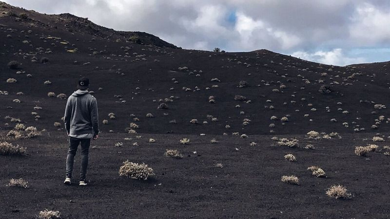 VLCN Rear View Outdoors Real People Mountain Men One Person Nature Sky Landscape Adventure Beauty In Nature Day People Dessert Stone Vulcan Fire Lava Black