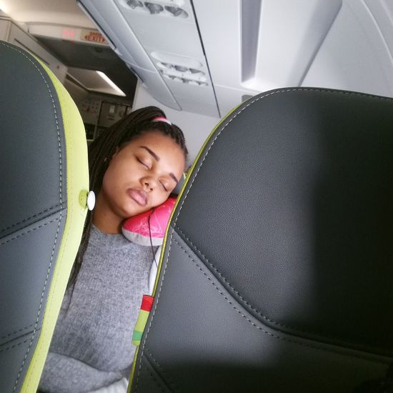 Young Women Smiling Women Happiness City Portrait Close-up Airplane Passenger Sleeping Airplane Seat Aeroplane Vehicle Interior
