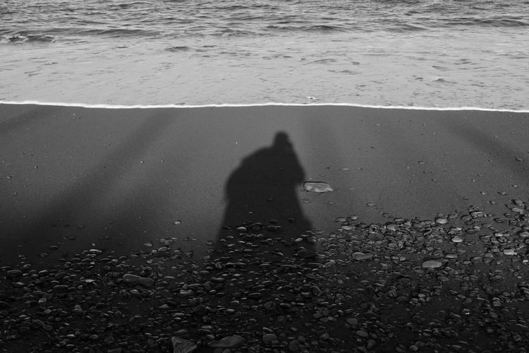 Shadow Of Person On Beach