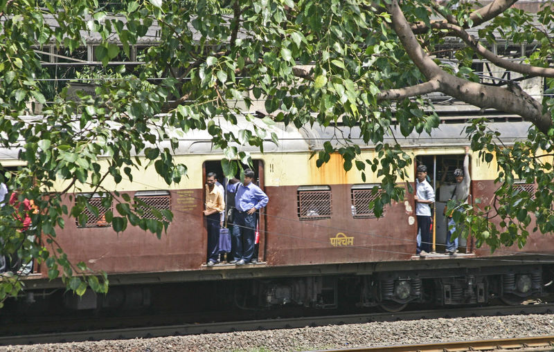 Indian Railways Mumbai Train Standing Room Only Adult Casual Clothing Day Full Length Growth Men Nature One Person Outdoors People Real People Standing Transportation Tree Women