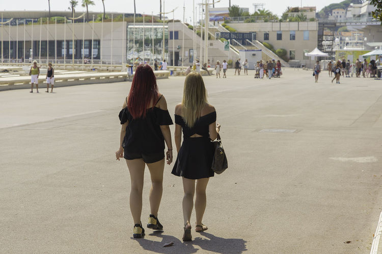 Summer day, two girls are walking near the Palais of Festival in Cannes. Black Dress Cannes, France Redhead Walking Girls Blond Hair Blonde Girl Girls Hairstyle Lifestyles Long Hair Outdoors Walking Women First Eyeem Photo