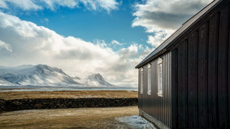 The black church Church Landscape_photography Iceland Blackchurch Cloud - Sky Sky Day Outdoors Building Exterior Mountain Architecture Built Structure Beauty In Nature No People Nature Scenics Water Travel Destinations