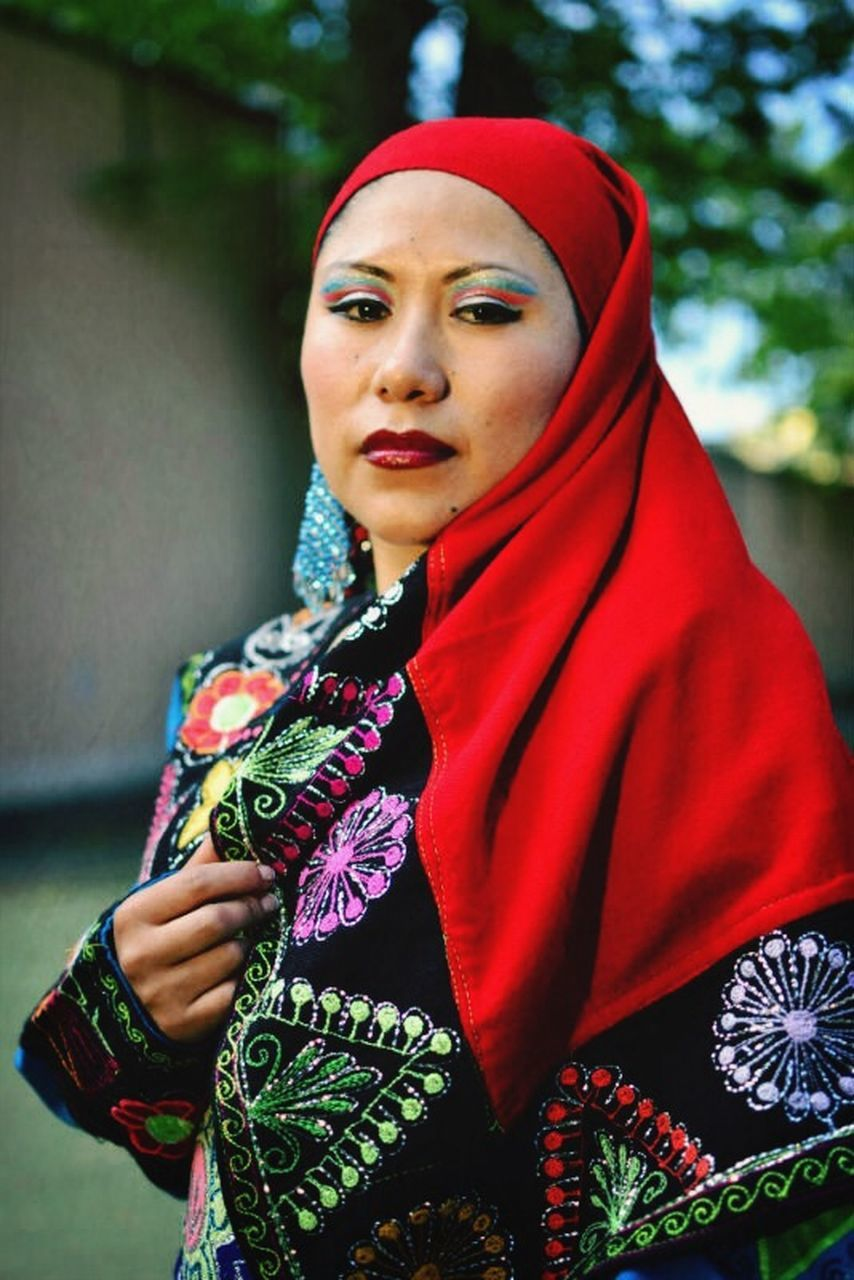 traditional clothing, young adult, one person, red, cultures, young women, beautiful woman, women, outdoors, one woman only, one young woman only, adult, lifestyles, veil, only women, beautiful people, beauty, people, real people, flower, adults only, day