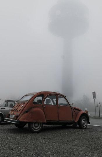 Vintage car against sky during foggy weather