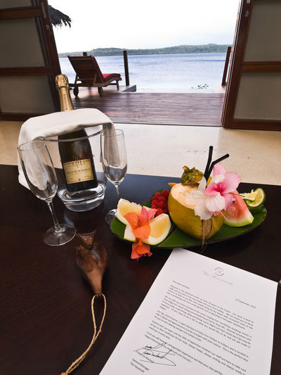 The Havannah Resort Havannah Harbour Efate, Vanuatu. Breathtaking Champagne Glasses Efate Island First Class Accomodations Flower Fresh Fruits Freshness Harbour View Havannah Resort Honeymoon Luxury Melanesia Over The Water Pacific Pacific Ocean Pardise Relaxing Rose - Flower Spa Pool Sunset Table Travel Travel Destinations Vanuatu Vivid International