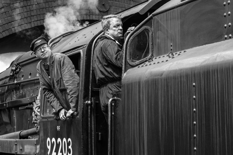 Train crew waiting for a signal to move the train. Taken at Weybourne Station, Norfolk, UK North Norfolk Railway Steam Steam Engine Train Station In Black And White Volunteering Black And White Black And White Photography Black And White Portrait Land Vehicle Men Mode Of Transportation Occupation People Portrait Real People Steam Locomotive Steam Train Steam Train Black And White Train Crew Train Driver Transportation Two Men At Work Volunteer Work Watching For Something