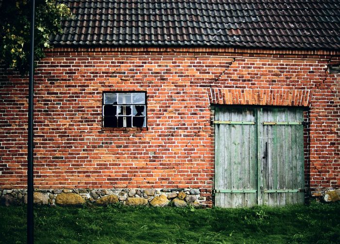 wall with broken window Broken Window Architecture Brick Brick Wall Building Building Exterior Built Structure Day Door Entrance Grass House Nature Outdoors Wall Wall - Building Feature Window