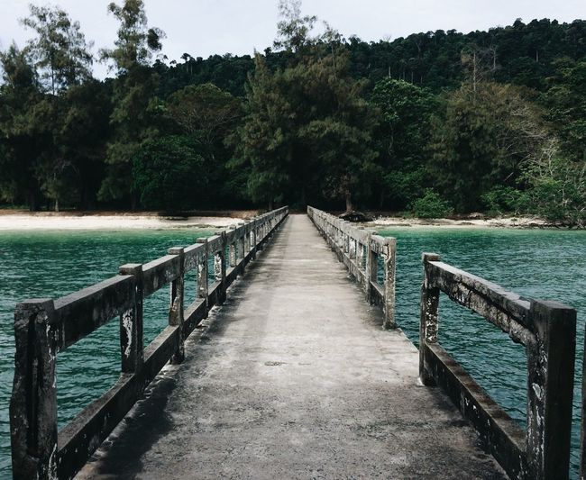 The old jetty Tranquility Pier Nature Tranquil Scene Outdoors The Way Forward Beauty In Nature Scenics Clear Sky Jetty VSCO Cam Green IPhoneography Island View  Island View  Travel Destinations Symmetry