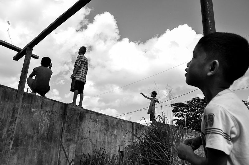 Flaneuring in Black and White Cloud - Sky Day Eyeem Philippines Kids Kite Leisure Activity Outdoors Philippines Sky Street Street Photography Streetphoto Streetphoto_bw Streetphotography Streetphotography_bw Summer The Street Photographer - 2016 EyeEm Awards