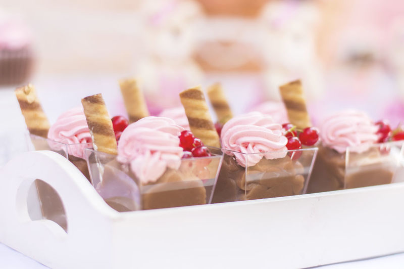 Close-up of dessert in container on tray