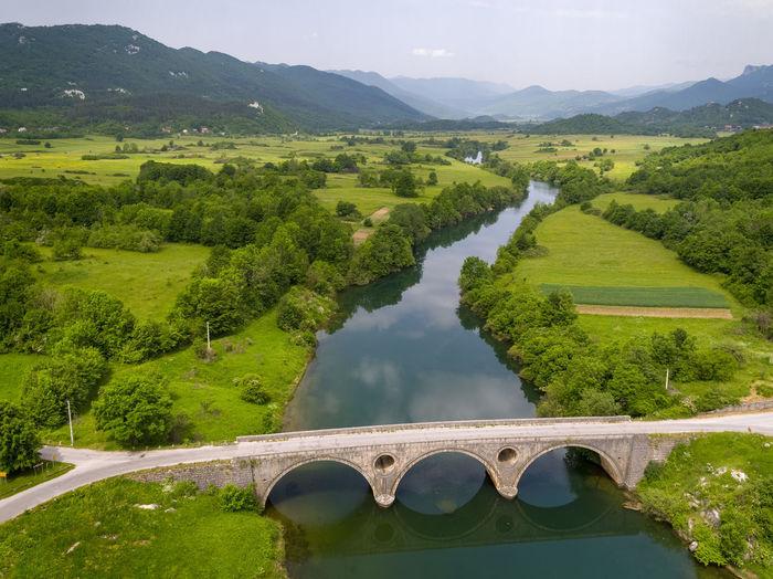 Aerial view of the old stone bridge on the lika river, croatia