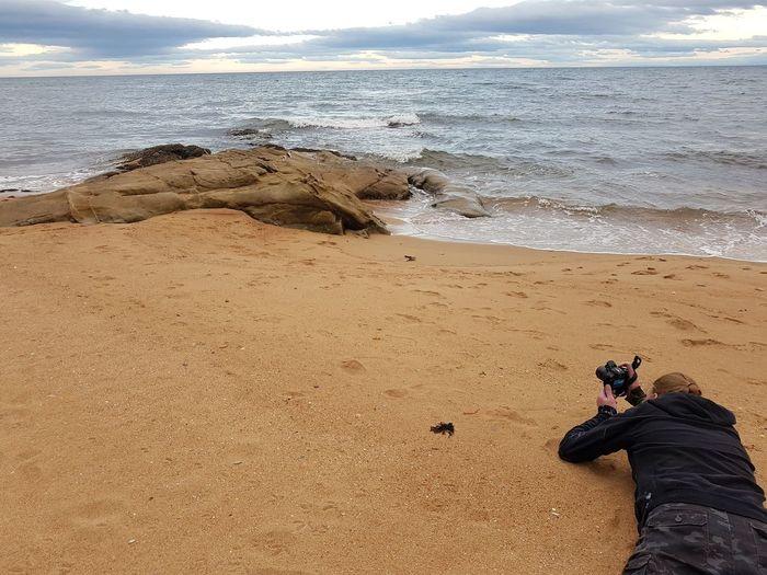 Man Taking Photos Focus Photography Scotland Scottish Highlands Scottish Coast Nc500 Water Sea Low Section Beach Men Sand Wave Shore Sky Sandy Beach Human Leg Ocean Personal Perspective