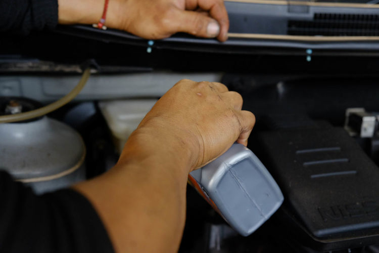 Filling brake fluid. Human Hand Hand Technology Human Body Part Occupation One Person Working Real People Indoors  Repairing Men Equipment Technician Connection Computer Equipment Adult Cable Holding Mechanic Keyboard Complexity Human Limb Brake Fluid Car