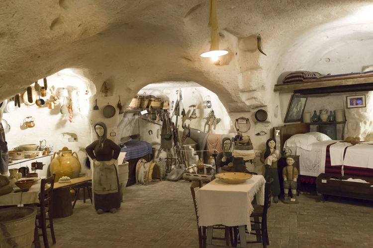 Matera Italy Unesco UNESCO World Heritage Site Grotto House Interior Ancient Cave Indoors  Illuminated Lighting Equipment Seat Architecture Chair Business No People Large Group Of Objects Table Choice Ceiling Furniture Empty Built Structure In A Row Old Travel