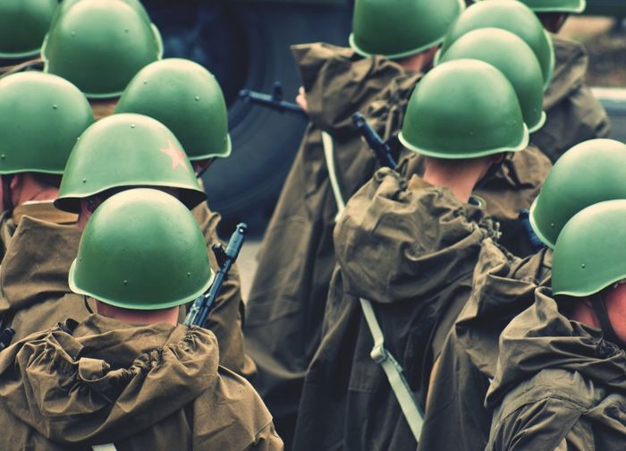 Close-up high angle view of army men in helmets