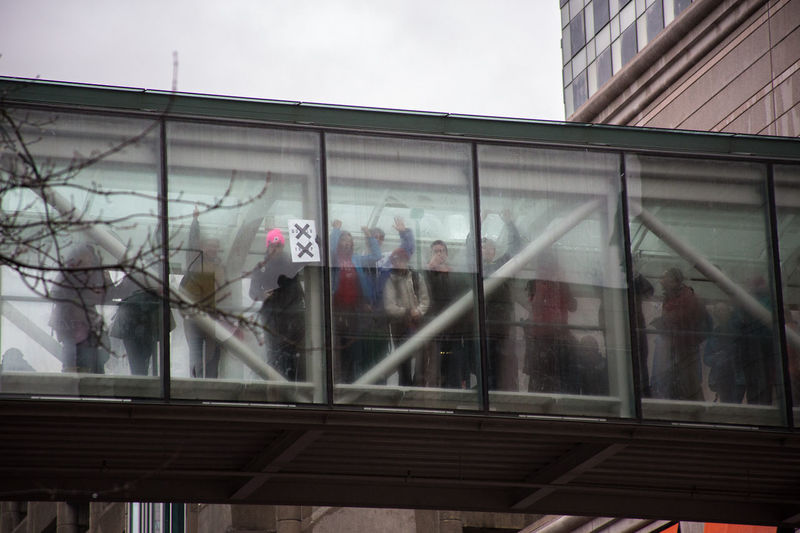Architecture Building Exterior Built Structure Day Foggy Onlookers Outdoors Protest Window