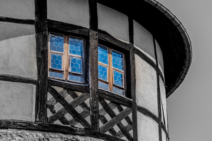 Windows in the Castle-Tower Abandoned Architecture Building Building Exterior Built Structure Close-up Day Design Electric Lamp Glass Glass - Material Low Angle View Nature No People Old Outdoors Pattern Sky Wall - Building Feature Window