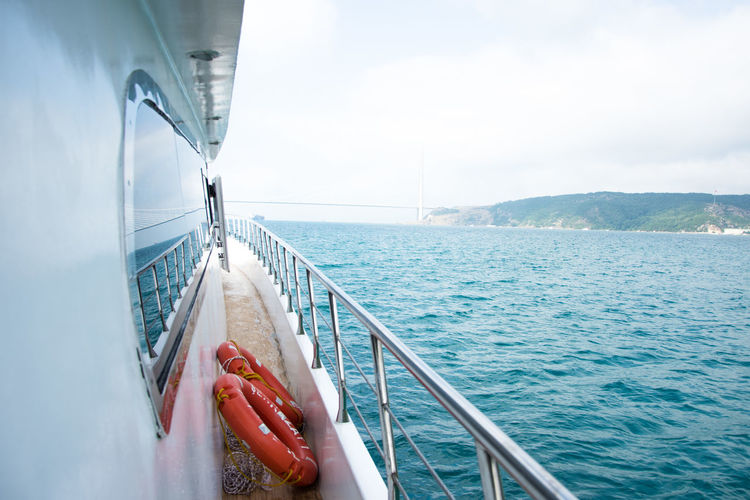 Adult Blue Boat Deck Close-up Day Horizon Over Water Low Section Nature Nautical Vessel Outdoors People Sailing Sailing Ship Sea Sky Transportation Water Yacht Yachting