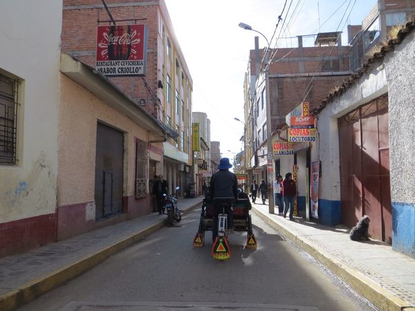 Architecture Building Exterior Built Structure Transportation Real People Full Length Riding The Way Forward Rear View Day Street Mode Of Transport Road One Person Outdoors Men Land Vehicle Bicycle Lifestyles City Peru Travel Destinations Lake Titicaca Puno, Perú Puno