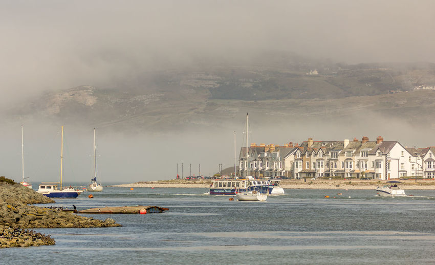 Conwy Estuary Beauty In Nature Boat Cloud - Sky Cloudy Day Harbor Mast Mode Of Transport Mountain Nature Nautical Vessel No People Outdoors Sailboat Scenics Sky Tranquil Scene Water Weather