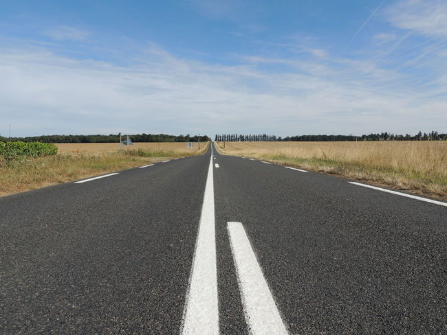 Loire Touraine Asphalt Cloud - Sky Day Diminishing Perspective Direction Dividing Line Empty Road Environment Landscape Marking Nature No People Non-urban Scene Outdoors Road Road Marking Sign Sky Surface Level Symbol The Way Forward Transportation vanishing point