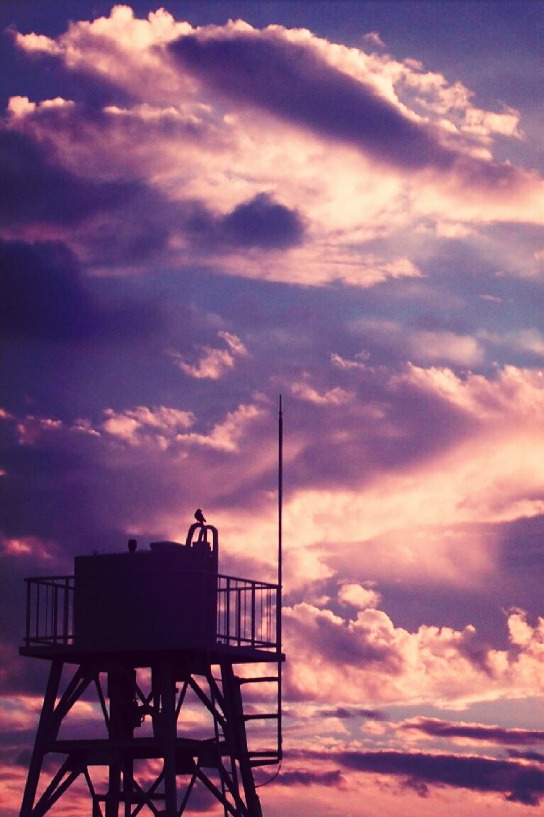 sky, sunset, cloud - sky, silhouette, cloudy, low angle view, cloud, orange color, dramatic sky, built structure, communication, nature, beauty in nature, weather, outdoors, tranquility, scenics, architecture, overcast, no people