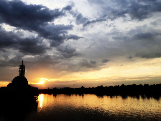 EyeEmNewHere Silhouette Sunset Silhouettes Water Reflections Beauty In Nature Built Structure Cloud - Sky Outdoor Photography