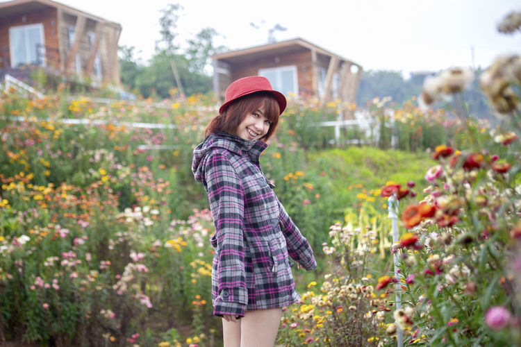 Girl in wild Architecture Beautiful Woman Building Exterior Casual Clothing Day Focus On Foreground Growth Hairstyle Happiness Leisure Activity Lifestyles Looking At Camera Nature One Person Outdoors Plant Portrait Real People Smiling Standing Three Quarter Length Women