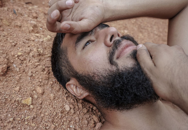 Close-up of young man lying down