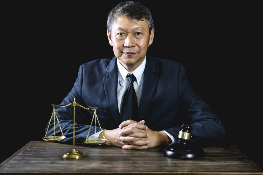 Portrait Looking At Camera Studio Shot Businessman Business Business Person Mature Adult Well-dressed Black Background Formalwear Suit Mature Men Menswear Ceo Counselor Fairness Barrister Gavel Balance Judgement Lawyer Courtroom Notary Legal Verdict