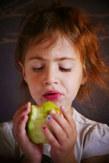 Close-Up Of Girl Eating Apple