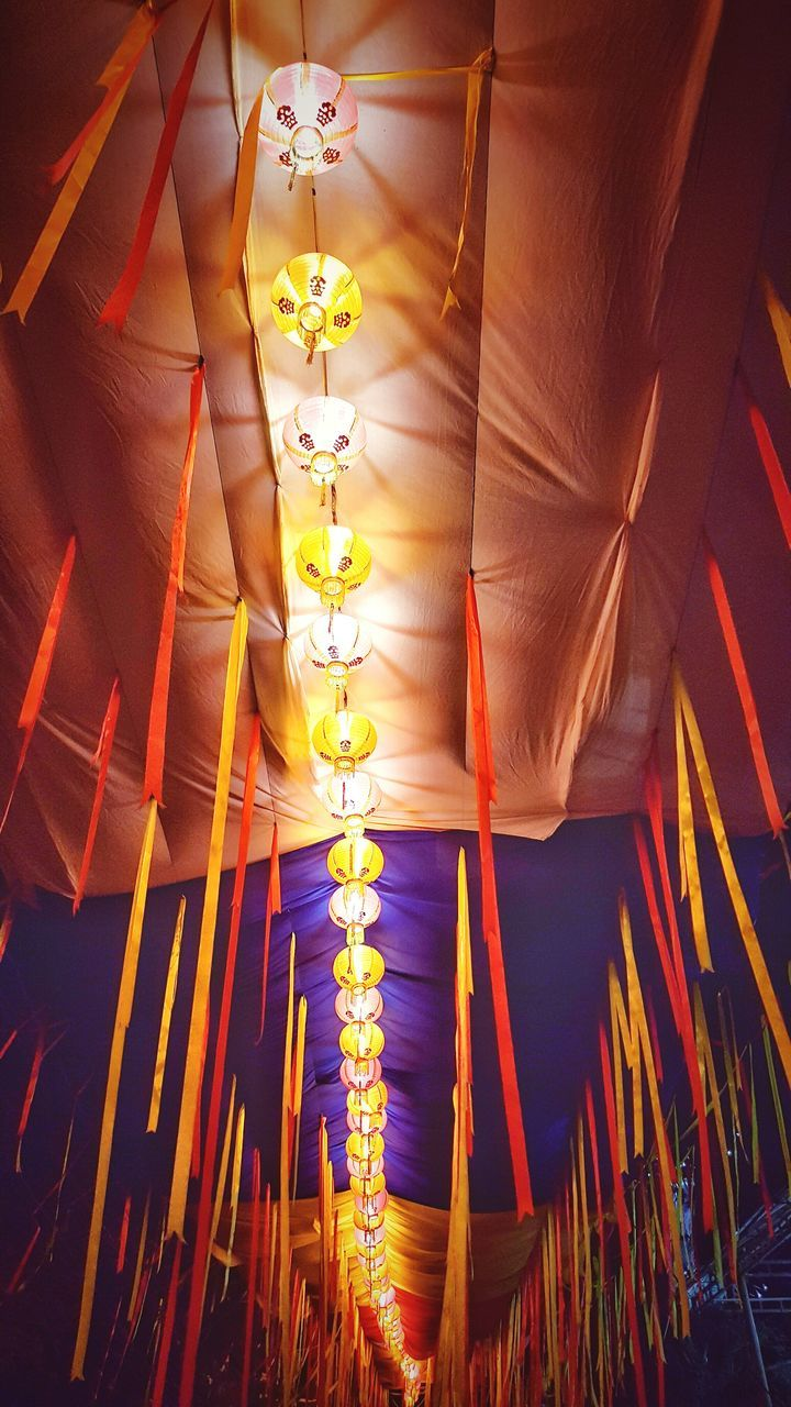 illuminated, low angle view, celebration, hanging, indoors, curtain, no people, close-up, night, low section